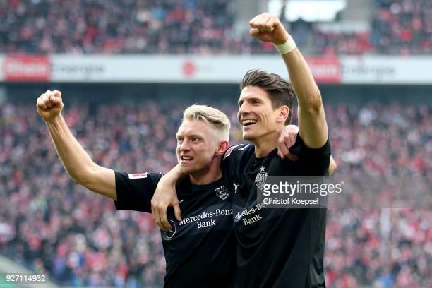 Andreas Beck of Stuttgart celebrates the third goal with Mario Gomez of Stuttgart during the Bundesliga match between 1 FC Koeln and VfB Stuttgart at...