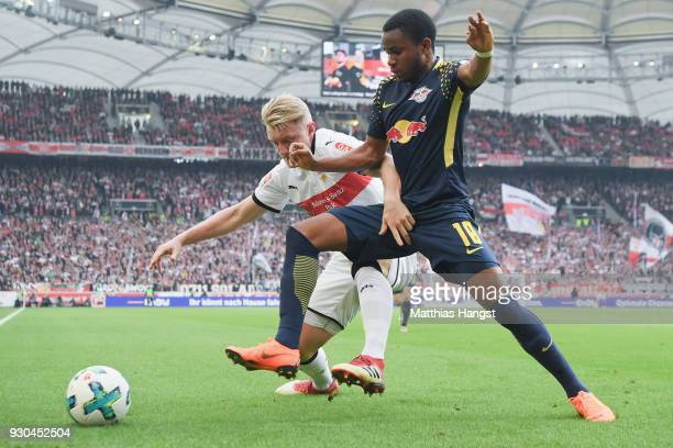 Andreas Beck of Stuttgart is challenged by Ademola Lookman of Leipzig during the Bundesliga match between VfB Stuttgart and RB Leipzig at...