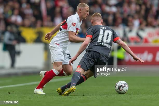 Andreas Beck of VfB Stuttgart and Sebastian Kerk of 1. FC Nuernberg battle for the ball during the Bundesliga match between VfB Stuttgart and 1. FC...