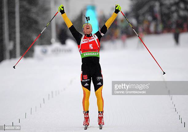 Andreas Birnbacher of Germany celebrates after winning the IBU World Cup Biathlon Oberhof Men's 15km Mass Start race at DKB Ski Arena on January 8,...