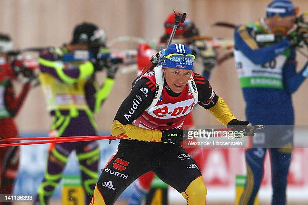 Andreas Birnbacher of Germany leaves the shooting range after his last shooting competes in the Men's 15km Mass Start during the IBU Biathlon World...