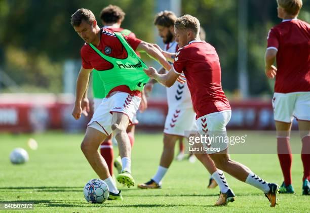 Andreas Bjelland and Viktor Fischer in action during the Denmark training session at Helsingor Stadion on August 29 2017 in Helsingor Denmark