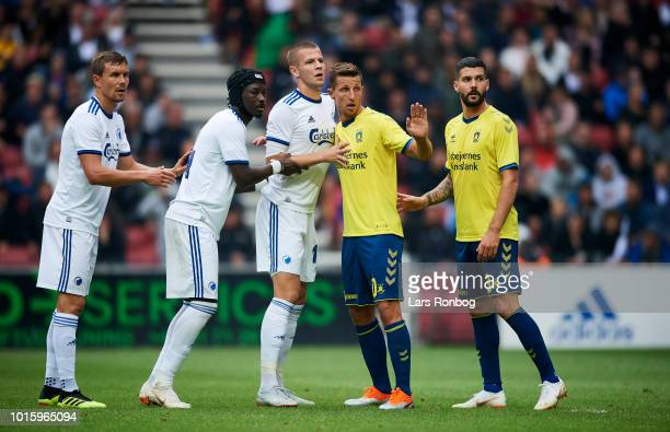 Andreas Bjelland Dame N'Doye and Denis Vavro of FC Copenhagen in action against Kamil Wilczek and Anthony Jung of Brondby IF during the Danish...