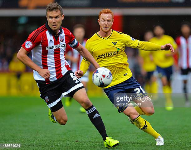 Andreas Bjelland of Brentford and Ryan Taylor of Oxford United during the Capital One Cup First Round match between Brentford and Oxford United at...