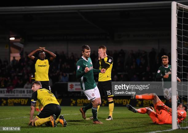 Andreas Bjelland of Brentford celebrates his sides first goal as Kyle McFadzean of Burton Albion scores a own goal during the Sky Bet Championship...