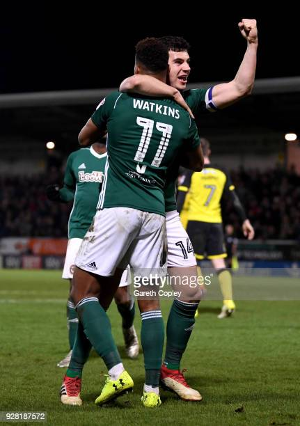 Andreas Bjelland of Brentford celebrates his sides first goal with Ollie Watkins of Brentford as Kyle McFadzean of Burton Albion scored a own goal...