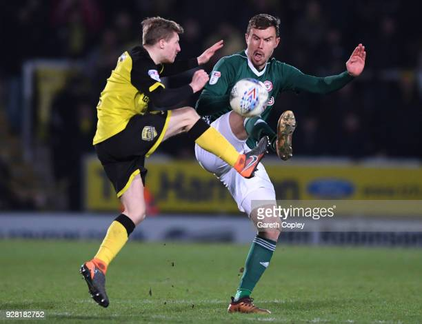 Andreas Bjelland of Brentford is challenged by Jamie Allen of Burton Albion during the Sky Bet Championship match between Burton Albion and Brentford...