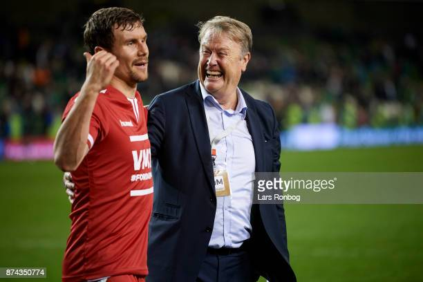 Andreas Bjelland of Denmark and Age Hareide head coach of Denmark celebrate after the FIFA 2018 World Cup Qualifier PlayOff Second Leg match between...