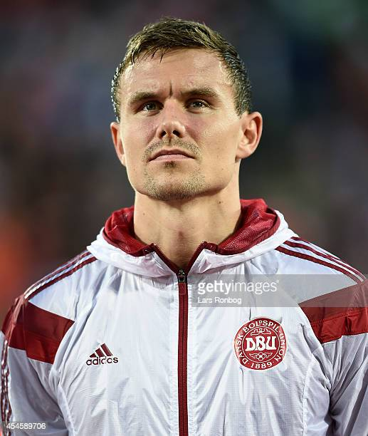 Andreas Bjelland of Denmark looks on as the team lines up prior to the international friendly between Denmark and Turkey at TreFor Park on September...