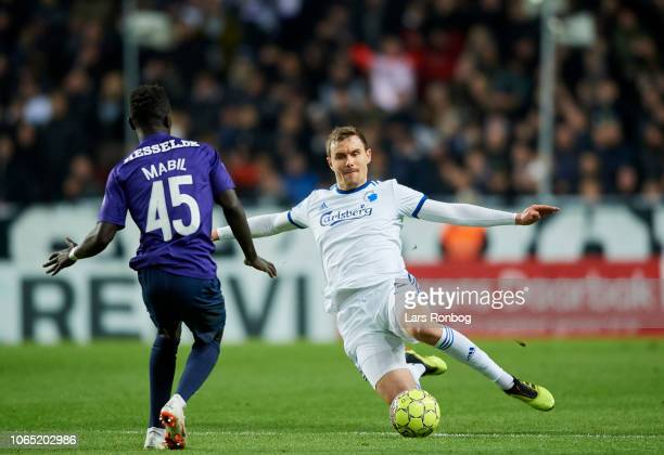 Andreas Bjelland of FC Copenhagen and Awer Mabil of FC Midtjylland compete for the ball during the Danish Superliga match between FC Copenhagen and...