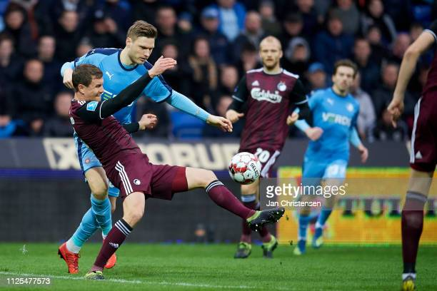 Andreas Bjelland of FC Copenhagen and Benjamin Stokke of Randers FC compete for the ball during the Danish Superliga match between Randers FC and FC...