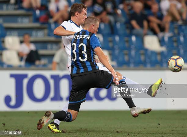 Andreas Bjelland of FC Copenhagen competes for the ball with Hans Hateboer of Atalanta BC during the UEFA Europa League PlayOff first leg match...