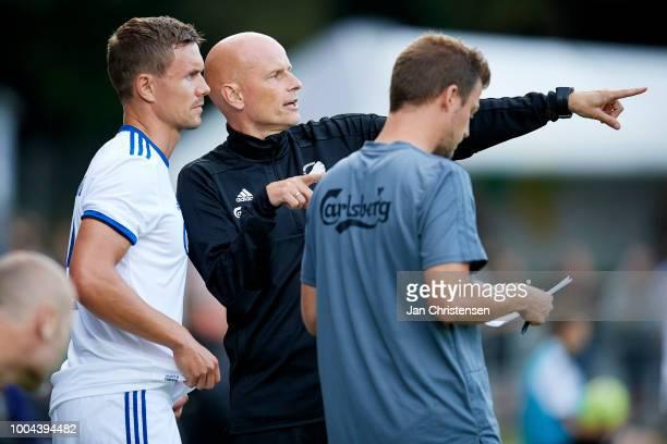 Andreas Bjelland of FC Copenhagen gets instructions from Stale Solbakken head coach of FC Copenhagen during the Danish Superliga match between Hobro...