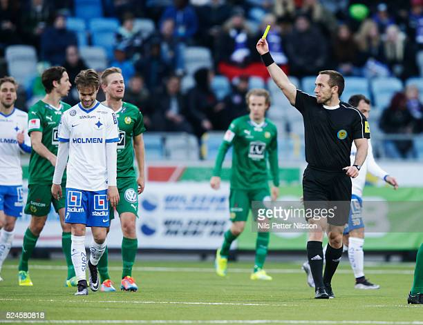 Andreas Blomqvist of IFK Norrkoping is shown a yellow card by Kaspar Sjoberg referee during the allsvenskan match between IFK Norrkoping and Hammarby...