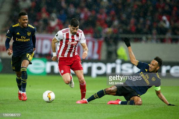 Andreas Bouchalakis of Olympiacos FC attacking Joe Willock of Arsenal FC and PierreEmerick Aubameyang of Arsenal FC during the UEFA Europa League...