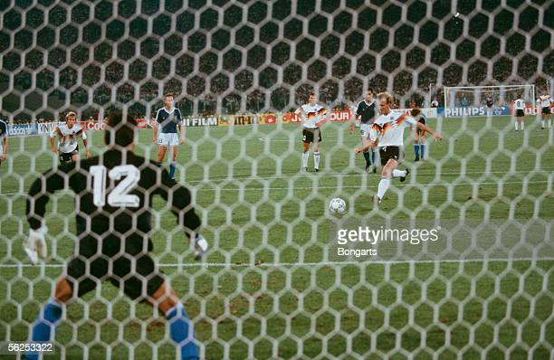 Andreas Brehme of Germany scores the first goal by penalty kick during the World Cup final match between Germany and Argentina at the Olympicstadium...