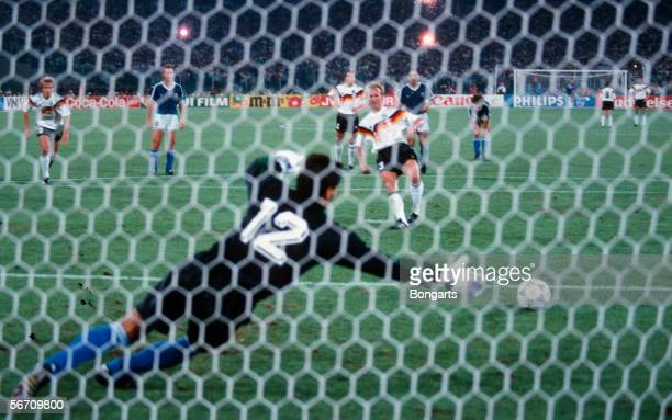 Andreas Brehme of Germany scores the first goal by penalty kick during the World Cup final match between Germany and Argentina on July 08 1990 in...