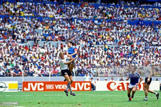 Andreas Brehme of West Germany FRG and Michel Platini of France during the World Cup semi final match between West Germany FRG and France played in...