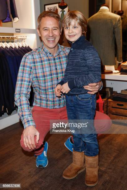 Andreas Brucker and his son Noah Heinrich attend the Anton Meyer store opening on March 22 2017 in Hamburg Germany
