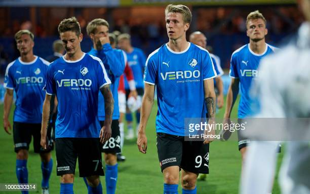 Andreas Bruhn and Emil Riis Jakobsen of Randers FC leaving the pitch dejected after the Danish Superliga match between Randers FC and Brondby IF at...