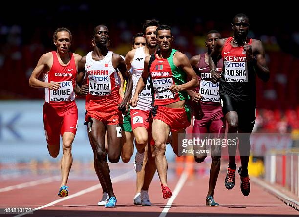 Andreas Bube of Denmark, Abraham Kipchirchir Rotich of Bahrain, Wais Ibrahim Khairandesh of Afghanistan and David Lekuta Rudisha of Kenya cross the...