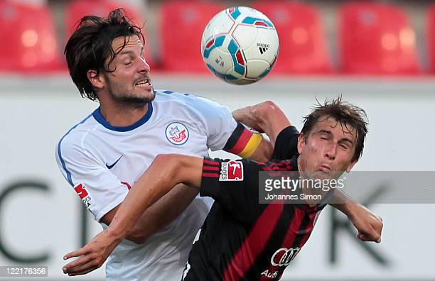 Andreas Buchner of Ingolstadt fights for the ball with Sebastian Pelzer of Rostock during the Second Bundesliga match between FC Ingolstadt and Hansa...