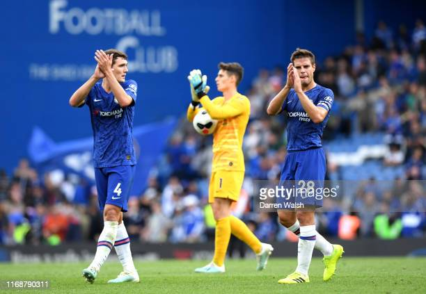 Andreas Christensen and Cesar Azpilicueta of Chelsea applaud fans following the Premier League match between Chelsea FC and Leicester City at...
