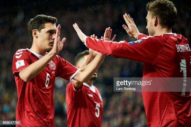 Andreas Christensen and Nicklas Bendtner of Denmark celebrate after scoring their first goal during the FIFA World Cup 2018 qualifier match between...