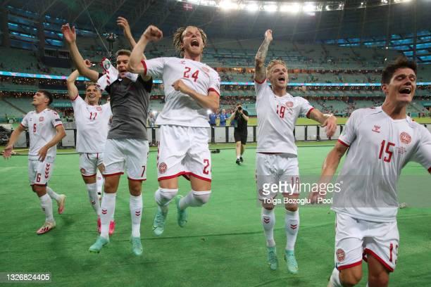 Andreas Christensen, Jens Stryger Larsen, Robert Skov, Mathias Jensen, Daniel Wass and Christian Norgaard of Denmark celebrate their side's victory...