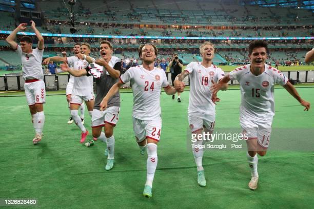 Andreas Christensen, Jens Stryger Larsen, Robert Skov, Mathias Jensen, Daniel Wass and Christian Norgaard of Denmark celebrates their side's victory...
