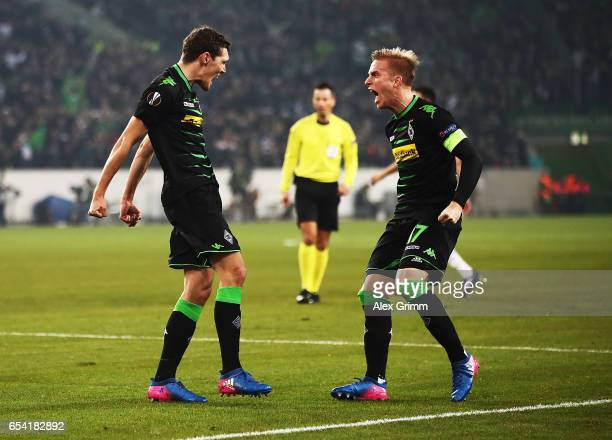Andreas Christensen of Borussia Moenchengladbach celebrates with Oscar Wendt after scoring a goal during the UEFA Europa League Round of 16 second...