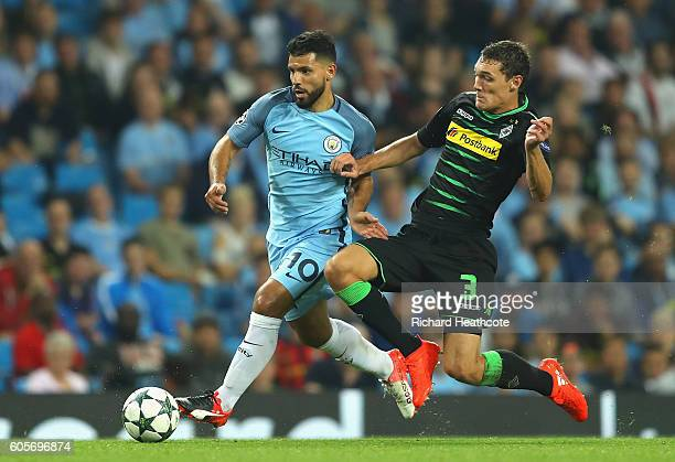 Andreas Christensen of Borussia Moenchengladbach challenges Sergio Aguero of Manchester City for the ball during the UEFA Champions League match...