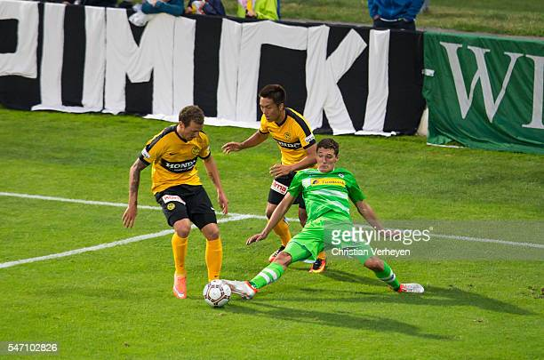 Andreas Christensen of Borussia Moenchengladbach Steve von Bergen and Kubo Yuya of Young Boys Bern battle for the ball during a friendly match...