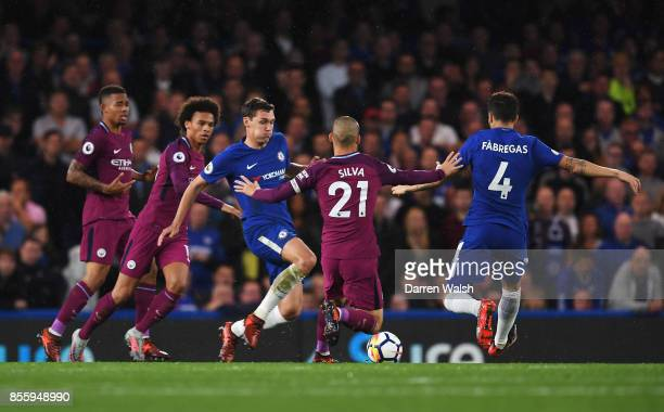 Andreas Christensen of Chelsea and Cesc Fabregas of Chelsea battle for possession with David Silva of Manchester City during the Premier League match...
