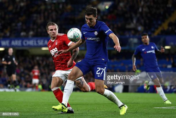 Andreas Christensen of Chelsea and Jason Cummings of Nottingham Forest battle for possession during the Carabao Cup Third Round match between Chelsea...