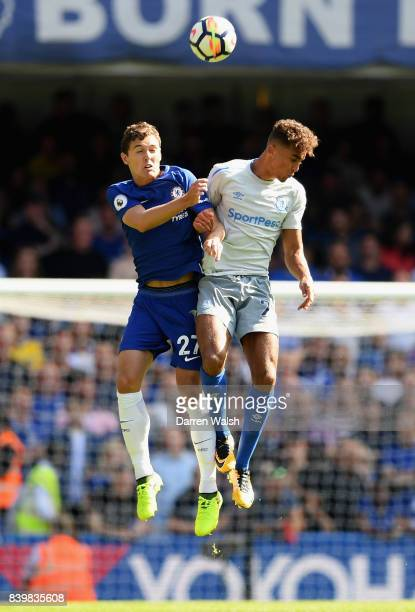 Andreas Christensen of Chelsea and Mason Holgate of Everton battle for possession in the air during the Premier League match between Chelsea and...