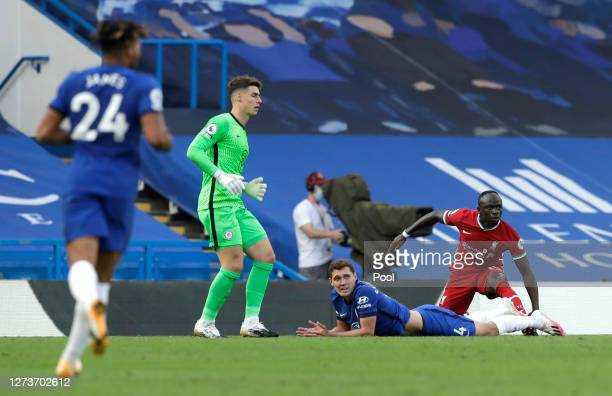 Andreas Christensen of Chelsea and Sadio Mane of Liverpool react after Andreas Christensen of Chelsea fouls Sadio Mane of Liverpool leading to a red...