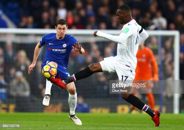 Andreas Christensen of Chelsea battles for possesion with Christian Benteke of Crystal Palace during the Premier League match between Chelsea and...