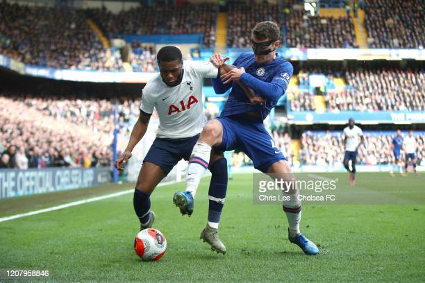 Andreas Christensen of Chelsea battles for possession with Japhet Tanganga of Tottenham Hotspur during the Premier League match between Chelsea FC...