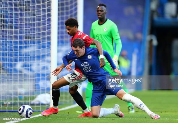 Andreas Christensen of Chelsea battles for possession with Marcus Rashford of Manchester United during the Premier League match between Chelsea and...