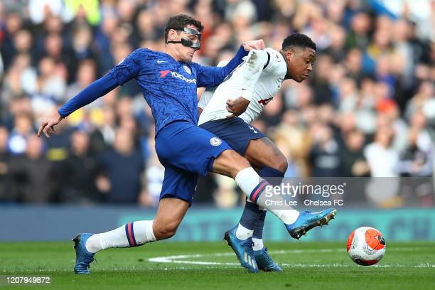 Andreas Christensen of Chelsea battles for possession with Steven Bergwijn of Tottenham Hotspur during the Premier League match between Chelsea FC...