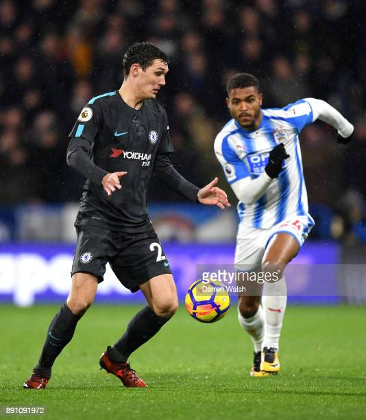 Andreas Christensen of Chelsea controls the ball under pressure from Steve Mounie of Huddersfield Town during the Premier League match between...