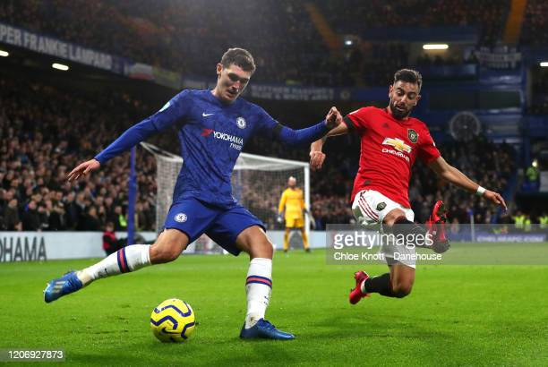 Andreas Christensen of Chelsea FC and Bruno Fernandes of Manchester United in action during the Premier League match between Chelsea FC and...
