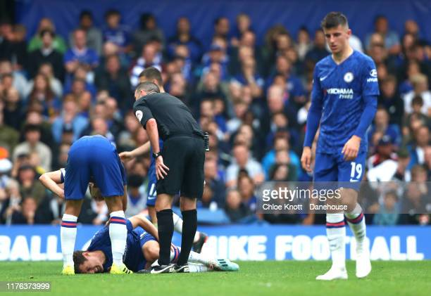 Andreas Christensen of Chelsea FC gets injured during the Premier League match between Chelsea FC and Liverpool FC at Stamford Bridge on September 22...