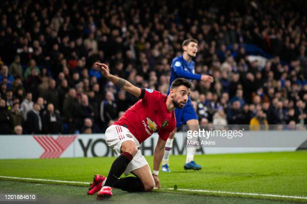 Andreas Christensen of Chelsea in action with Bruno Fernandes of Manchester United during the Premier League match between Chelsea FC and Manchester...