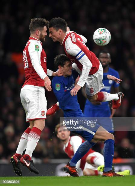 Andreas Christensen of Chelsea is tackled from both sides by Shkodran Mustafi and Laurent Koscielny of Arsenal during the Carabao Cup SemiFinal...