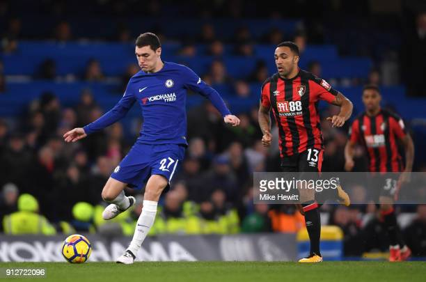 Andreas Christensen of Chelsea passes the ball under pressure from Callum Wilson of AFC Bournemouth during the Premier League match between Chelsea...