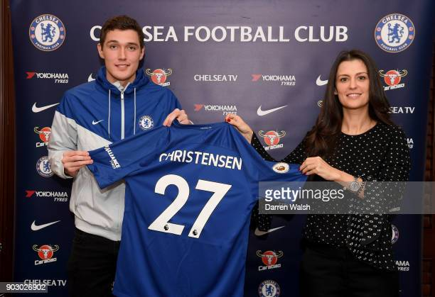 Andreas Christensen of Chelsea signs a new contract alongside Marina Granovskaia at Stamford Bridge on January 9 2018 in London England