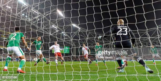 Andreas Christensen of Denmakr shoots and his shot is deflected in by Cyrus Christie of the Republic of Ireland for a own goal and Denmark's first...
