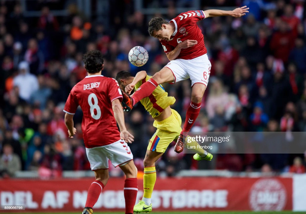 Andreas Christensen of Denmark and Florin Andone of Romania compete for the ball during the FIFA World Cup 2018 qualifier match between Denmark and Romania at Telia Parken Stadium on October 8, 2017 in Copenhagen, Denmark.